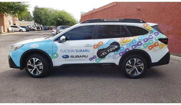 Wrapping a subaru as a pace car for the Tucson El Tour de Tucson bicycle event.
